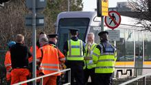 Gardai and LUAS staff at the scene on Cookstown Way, near Tallaght where a woman was killed in a collision with a LUAS tram.Picture Colin Keegan, Collins Dublin