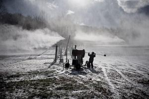 A Roundtop Mountain Resort employee makes snow in Lewisberry, Pennsylvania, as arctic air arrived in the midstate area with temperatures reaching 30 degrees.  (AP Photo/PennLive.com, Sean Simmers)