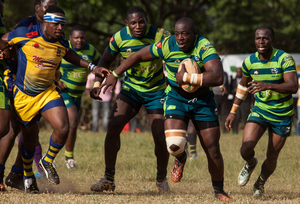 Oscar Simiyu of KCB makes a move in their game against Homeboyz in what was a hard-fought battle. Photo: Eric Onchiri