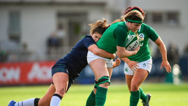 Anna Caplice of Ireland is tackled by Lisa Thomson of Scotland. Photo: Ramsey Cardy/Sportsfile