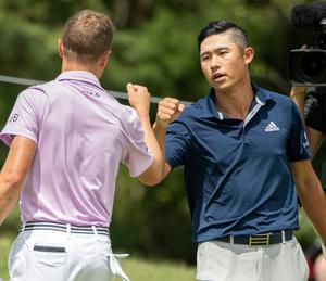 Collin Morikawa gets a fist bump from Justin Thomas after defeating him in a three-hole playoff to win the Workday Charity Open. Photo: USA TODAY Sports