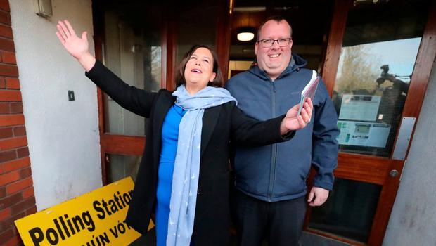 POLL POSITIONS: Sinn Fein's Mary Lou McDonald, with councillor Seamas McGrattan, casting her vote in Dublin. Photo: Niall Carson/PA Wire