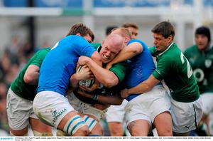 25 February 2012; Paul O'Connell, Ireland, supported by Ronan O'Gara, right, is tackled by Antonio Pavanello, left, and Leonardo Ghiraldini, Italy. RBS Six Nations Rugby Championship, Ireland v Italy, Aviva Stadium, Lansdowne Road, Dublin. Picture credit: Brendan Moran / SPORTSFILE