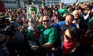 22/03/2015 Irish fans with the 6 nations trophy after the Irish Rugby side  arrived  at Dublin Airport following their 6 Nations Championship win  Photo:  Gareth Chaney Collins