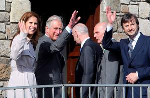 Prince Charles waves alongside Timothy Knatchbull, whose twin brother Nicholas was killed in the IRA bomb
