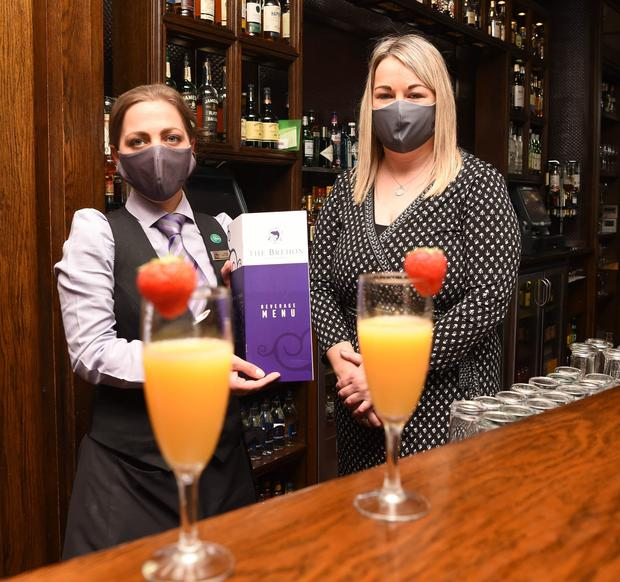 Pebbles Knight and Sinead McCarthy getting the bar area ready for re-opening at The Brehon, Killarney. Photo by Michelle Cooper Galvin