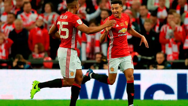 Manchester United's Jesse Lingard (right) celebrates scoring his side's second goal of the game with Antonio Valencia (left) in EFL Cup final