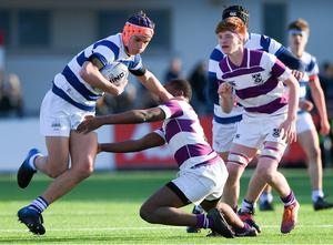 Tom Brigg of Blackrock College is tackled by Kosi Ugwuere of Clongowes Wood College during the Bank of Ireland Leinster Schools Junior Cup Second Round match at Energia Park in Dublin. Photo by Matt Browne/Sportsfile