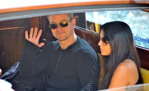 Matt Damon, left and his wife Luciana Barroso, arrive at Venice Lido, Italy,  Friday, Sept. 26, 2014. Actor director George Clooney revealed earlier this month at a star-studded benefit in Florence that he would marry human rights lawyer Amal Alamuddin in the lagoon city, but refrained from giving the date. (AP Photo/Luigi Costantini)