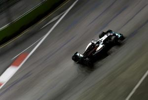 Lewis Hamilton drives during the first practice session of the Singapore F1 Grand Prix