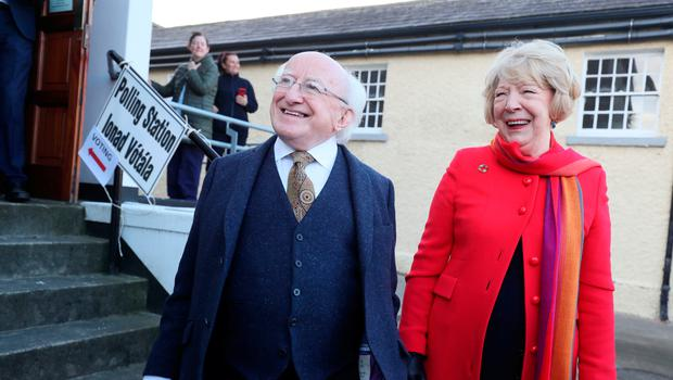 President Michael D Higgins and his wife Sabina Coyne leaving the polling station at St Mary's Hospital in Phoenix Park, Dublin after casting their votes in the Irish General Election. Brian Lawless/PA Wire