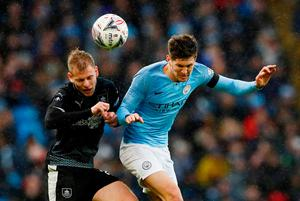 Manchester City's John Stones heads the ball. Photo: Jason Cairnduff/Action Images via Reuters