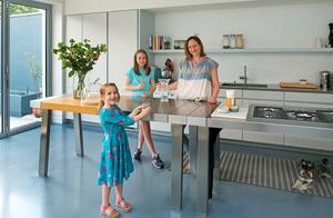 Alja Kramberger with her daughters in the kitchen of their modernised Edwardian red-brick.