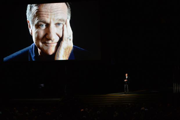 Actor Billy Crystal (R) speaks in tribute to the late Robin Williams onstage at the 66th Annual Primetime Emmy Awards held at Nokia Theatre L.A. Live on August 25, 2014 in Los Angeles, California. (Photo by Kevin Winter/Getty Images)