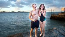 Simon Walkin from Booterstown and Catherine McLoughlin from Rathfarnham take the plunge into the cold waters at Sandycove beach on New Year's Day. Photo: Tony Gavin