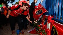 Munster supporters pay their respects following the passing of Munster head coach Anthony Foley in Paris