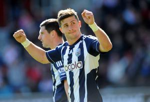 West Bromwich Albion's Shane Long celebrates scoring his side's third goal during the Barclays Premier League match at St Marys
