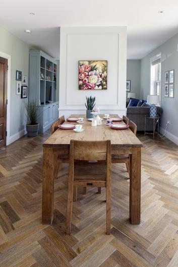 The reclaimed-teak kitchen table and chairs were given to Ciara by her sister Denise, when she was moving abroad. One of Ciara's cabinet makers built the unit, which is painted in a Colourtrend shade. Photo: Tony Gavin