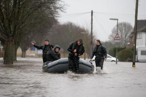 Members of the army rescue residents  in Egham, Surrey. PRESS ASSOCIATION Photo. Picture date: Wednesday February 12, 2014. See PA story WEATHER Floods. Photo credit should read: Steve Parsons/PA Wire