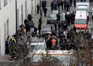 General view of police and rescue vehicles at the scene after a shooting at the Paris offices of Charlie Hebdo, a satirical newspaper, January 7, 2015. REUTERS/Philippe Wojazer