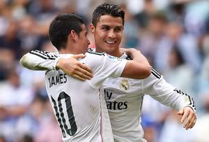 Cristiano Ronaldo celebrates with James Rodriguez after scoring his Real Madrid's sixth goal in their 8-2 La Liga victory over Deportivo La Coruna at the Riazor Stadium. Photo: David Ramos/Getty Images