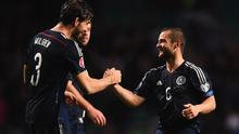 Charlie Mulgrew (3) and Shaun Maloney of Scotland (6) celebrate victory after the EURO 2016 Group D Qualifier match between Scotland and Republic of Ireland at Celtic Park