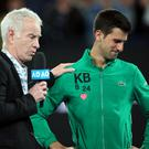 Serbia's Novak Djokovic reacts after his match against Canada's Milos Raonic as he is interviewed by former tennis player John McEnroe during the Australian Open quarter-final win in Melbourne. Photo: Reuters/Hannah Mckay