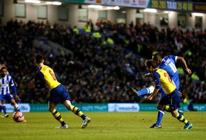 Brighton and Hove Albion's Chris O'Grady (R) scores a goal against Arsenal during their FA Cup fourth round soccer match at the Amex stadium in Brighton, southern England January 25, 2015.    REUTERS/Stefan Wermuth (BRITAIN - Tags: SPORT SOCCER)