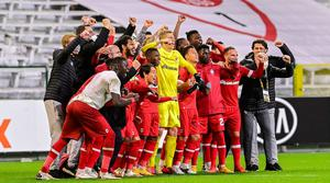 Royal Antwerp players celebrate their victory. Photo: PA