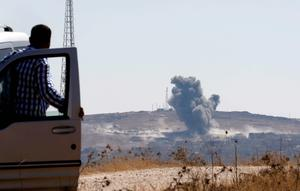Smoke rises from the Syrian town of Kobani, seen from near the Mursitpinar border crossing on the Turkish-Syrian border in the southeastern town of Suruc in Sanliurfa province. Reuters