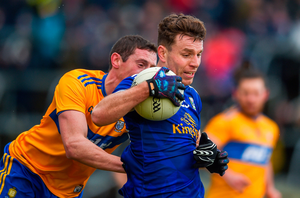 Conor Madden of Cavan in action against Tony Kelly of Clare. Photo by Philip Fitzpatrick/Sportsfile