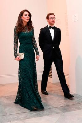 Britain's Catherine, Duchess of Cambridge (L), walks with Nicholas Cullinan Director of the National Portrait Gallery, as she arrives to attend the 2017 Portrait Gala, at the National Portrait Gallery in London on March 28, 2017
