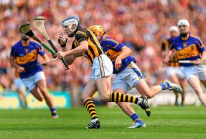 Kilkenny's TJ Reid tries to escape the attentions of Shane McGrath of Tipperary during the All-Ireland hurling final at Croke Park. Photo: Stephen McCarthy / SPORTSFILE