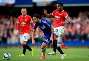 Manchester United's Luis Antonio Valencia (right) and Chelsea's Eden Hazard (left) battle for the ball during the Barclays Premier League match at Stamford Bridge, London. PRESS ASSOCIATION Photo. Picture date: Saturday April 18, 2015. See PA story SOCCER Chelsea. Photo credit should read: Nick Potts/PA Wire. RESTRICTIONS: Editorial use only. Maximum 45 images during a match. No video emulation or promotion as 'live'. No use in games, competitions, merchandise, betting or single club/player services. No use with unofficial audio, video, data, fixtures or club/league logos.