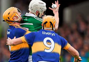 Limerick's Cian Lynch is bottled by by Padraic Maher (left) and Shane McGrath at the Gaelic Grounds yesterday.