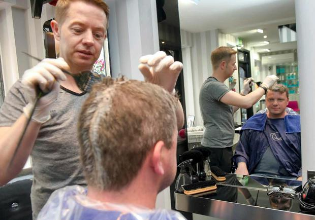 Graham Clifford has his hair dyed by Michael Maguire at D'Arcy's Hairdressing in Cork