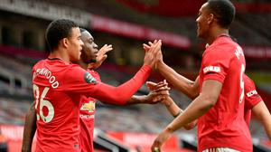 Manchester United's Mason Greenwood (left) celebrates scoring his side's fourth goal of the game with team-mates during the Premier League win over Bournemouth at Old Trafford