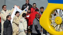 Medical staff holds sheets around Fernando Alonso of Spain and McLaren Honda as he is evacuated from the medical centre to the helicopter after crashing during the 2015 Formula One testing in Montmelo, Spain