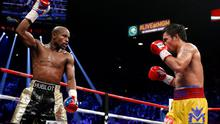 Floyd Mayweather Jr., left, celebrates during his welterweight title fight against Manny Pacquiao, from the Philippines, on Saturday, May 2, 2015 in Las Vegas