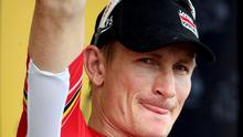 Lotto-Soudal rider Andre Greipel of Germany celebrates on podium after the 183-km (113.71 miles) 15th stage of the 102nd Tour de France cycling race from Mende to Valence, France, July 19, 2015.  REUTERS/Stefano Rellandini