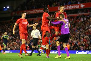 Liverpool's Lucas, Kolo Toure and Simon Mignolet celebrate after winning last night's Capital One Cup clash 14-13 on penalties against Middlesbrough. Photo: Alex Livesey/Getty Images