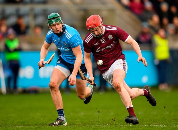 Thomas Monaghan of Galway in action against James Madden of Dublin. Photo by Harry Murphy/Sportsfile