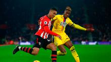 Yan Valery of Southampton holds off Wilfried Zaha of Crystal Palace. Photo by Jordan Mansfield/Getty Images