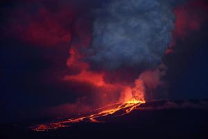 The Wolf volcano spews smoke and lava on Isabela Island, in this May 25, 2015 handout photograph provided by the Galapagos National Park. A volcano perched atop one of Ecuador's Galapagos Islands erupted in the early hours of Monday, the local authorities said, potentially threatening a unique species of pink iguanas. The roughly 1.7-kilometer (1.1-mile) high Wolf volcano is located on Isabela Island, home to a rich variety of flora and fauna typical of the archipelago that helped inspire Charles Darwin's theory of evolution following his 1835 visit. REUTERS/Galapagos National Park/Diego Paredes/Handout via Reuters     TPX IMAGES OF THE DAY    ATTENTION EDITORS - FOR EDITORIAL USE ONLY. NOT FOR SALE FOR MARKETING OR ADVERTISING CAMPAIGNS. THIS PICTURE WAS PROVIDED BY A THIRD PARTY. REUTERS IS UNABLE TO INDEPENDENTLY VERIFY THE AUTHENTICITY, CONTENT, LOCATION OR DATE OF THIS IMAGE. THIS PICTURE IS DISTRIBUTED EXACTLY AS RECEIVED BY REUTERS, AS A SERVICE TO CLIENTS. MANDATORY CREDIT.