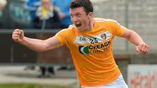 Antrim's Dermot McAleese celebrates scoring his side's crucial second goal in Portlaoise yesterday
