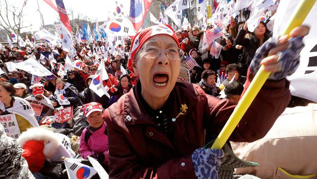 A supporter of South Korean President Park Geun-hye cries during a rally opposing her impeachment near the Constitutional Court in Seoul, South Korea (AP Photo/Ahn Young-joon)