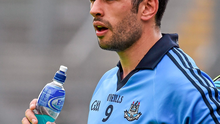 Cian O'Sullivan, Dublin, takes a drink before the start of the game