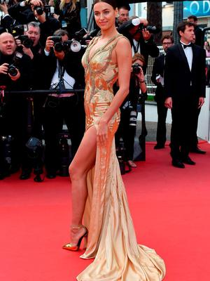"""Russian model Irina Shayk poses as she arrives for the screening of the film """"Sicario"""" at the 68th Cannes Film Festival"""