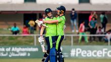 Ireland's Kevin O'Brien (L) and teammate Harry Tector. (Photo by MONEY SHARMA/AFP via Getty Images)