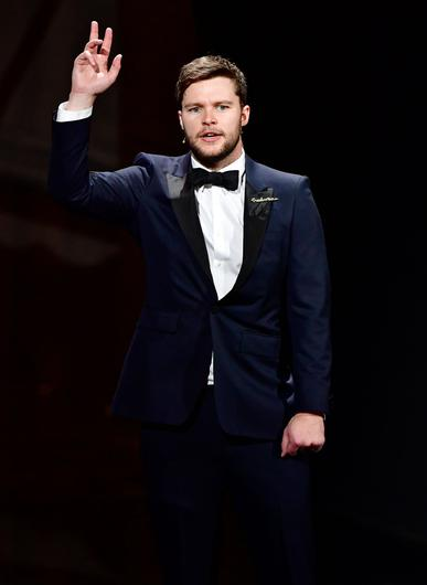 Irish actor Jack Reynor presents the short film award on stage during the 30th European Film Awards ceremony in Berlin, on December 9, 2017. / AFP PHOTO / POOL / Tobias SCHWARZ